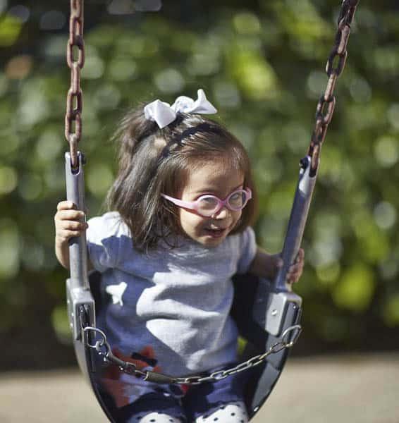 Girl on a swing in the big yard